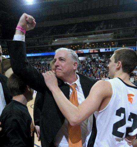 Solon's Brad Randall, celebrating here with Matt Morrison after a state-semifinal win over Western Christian, is the IBCA Class 2A Coach of the Year. (Gazette photo by Brian Ray)