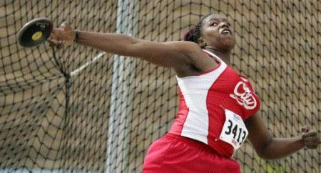Iowa City High's Majesty Tutson flings the discus during the Drake Relays Thursday. Tutson won the event with a toss of 138 feet, 9 inches. (Gazette photo by Jim Slosiarek)