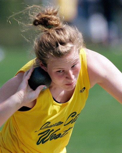 Micaela Haight winds up for a shot put attempt Friday at the state track meet. Haight won the Class 4A girls' title. (Photo by Brian Ray)