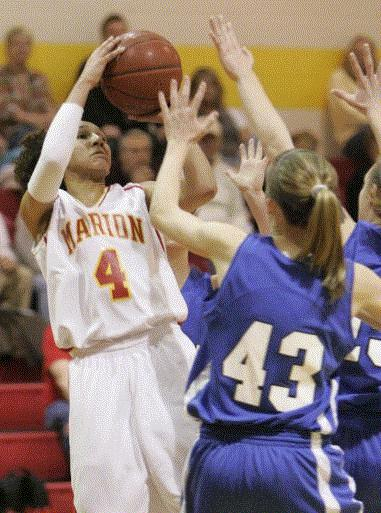 Marion's Morgan Paige, here shooting in a regional semifinal against Anamosa, has committed to play women's basketball at the University of Wisconsin. (Photo by Jim Slosiarek)