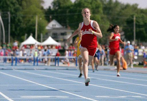 North Tama's Sara Stoakes races to victory in the girls' Class 1A 400-meter hurdles Friday at Drake Stadium. (Photo by Brian Ray)