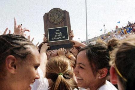Trophy celebrations, like this at the 2008 state track meet, are common for the Iowa City West girls. (Photo by Liz Martin)