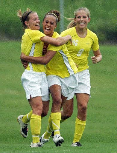 Cedar Rapids Kennedy's Jenny Snook (1) celebrates with Hannah Plagman (11) and Jade Grimm (9) after scoring the Cougars' first goal in a 2-0 win over Ankeny in a Class 2A semifinal at the girls' state soccer tournament Friday at Muscatine. (Photo by Brian Ray)