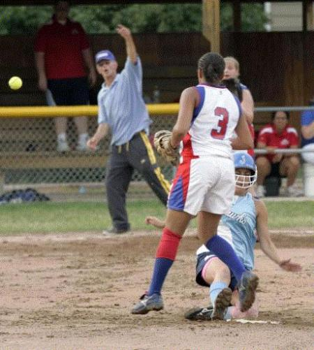 Cedar Rapids Jefferson's Brittany Madsen slides into second base as the ball gets away from Cedar Rapids Washington shortstop Jordan Carr in Jefferson's sweep Thursday. (Photo by Chris Mackler)